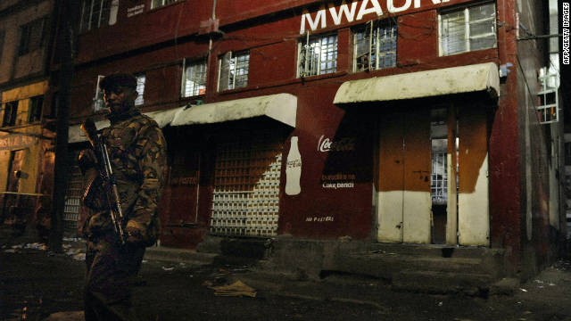 A Kenyan security officer secures the scene of a grenade attack in Nairobi, on October 24.