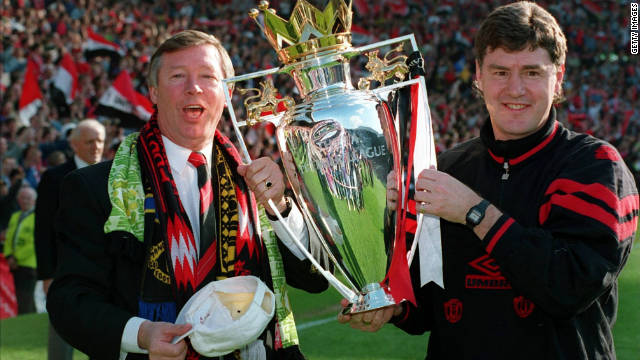 Ferguson celebrates with his assistant Brian Kidd after United won the Premiership again in 1994, then went on to secure a domestic double by beating Chelsea in the FA Cup final. United repeated the feat in 1996.