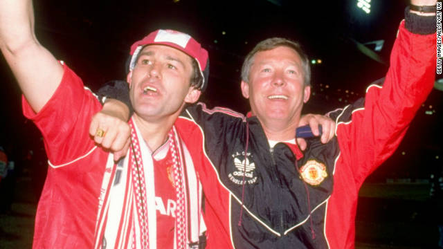 Ferguson survived a difficult first four years at Manchester United before winning a title -- the 1990 FA Cup. Here he celebrates with Bryan Robson, who became the first United captain to lift the trophy three times after beating Crystal Palace 1-0 in the final replay.