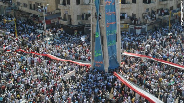Syrians demonstrate against the government after Friday prayers in Hama on July 29.