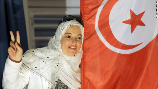 A supporter of Tunisia's Islamist Ennahda party celebrates Tuesday at the movement's headquarters in Tunis.
