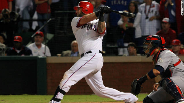 Mike Napoli hits a two-run double to put the Rangers 4-2 up in game five of baseball's World Series.
