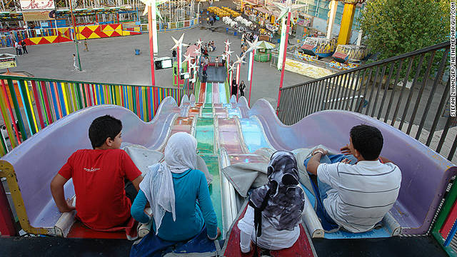A family prepares to tackle the slides at Eram Park.