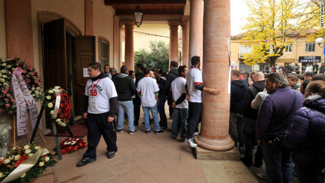 Motorsport fans gather outside the theater in the Italian town. The 24-year-old MotoGP rider died following a crash in Malaysia on Sunday.