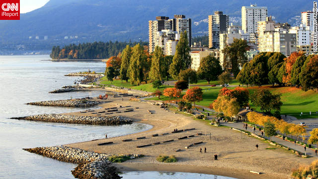 "Angus Praught snapped a shot of fall descending on Vancouver, British Columbia: ""Fall foliage near Sunset Beach in downtown Vancouver's West End, as seen from the Burrard Street Bridge while out walking during an early evening in October. Stanley Park and the North Shore Mountains can be seen in the far background."""