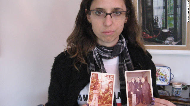 Marianela Galli, 35, holds photographs of family members who were tortured and killed during Argentina's