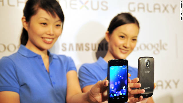 Models hold the new Samsung Galaxy Nexus Android phone during its official launch in Hong Kong on October 19, 2011.
