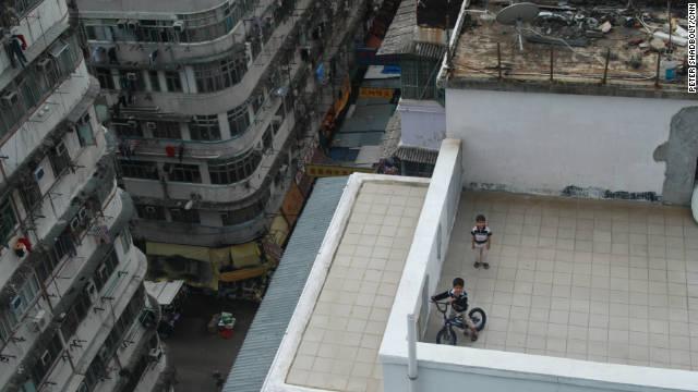 Children on a rooftop playground in Sham Shui Po.