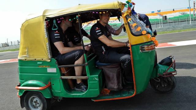 McLaren's former world champion driver Jenson Button hitches a ride in an autorickshaw as he inspects the track on Thursday.