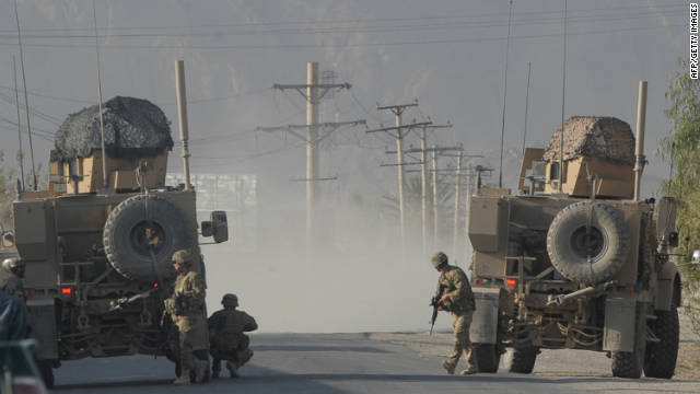 US soldiers keep watch on site during a gunfire near a US base in Kandahar on October 27.