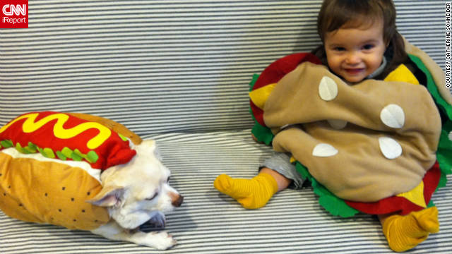 "Catherine Schneider of Bellport, New York, bought a hot dog costume first for her Chihuahua, Mary, and then found a hamburger outfit for son Bennett, figuring ""they'd really complement each other."" ""I don't think either one really knows what's happening,"" she says. ""But neither one tried to take it off."""