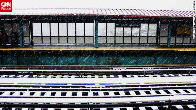 Snow covers the tracks of a New York subway station. Hundreds of thousands of people had lost electricity as of Saturday afternoon.