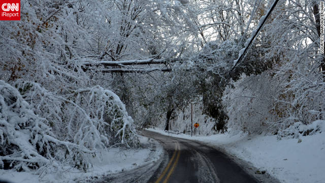 "Aaron Kershaw, an iReporter from Putnam County, New York, captured the aftermath of the unexpected snow in his community on Sunday, October 30. ""Lots of downed trees this late-morning, with the weight of the now wet snow makes for more breakage,"" said Kershaw."