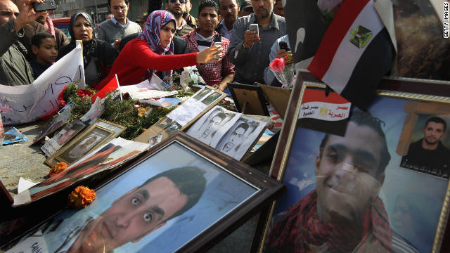 Egyptians pay their respects in Tahrir Square in February at a memorial for those killed by police during the uprising.