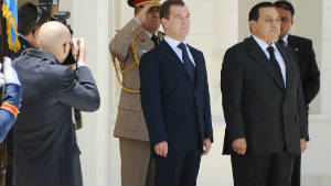 In action: Ahmed Mourad takes a photograph of former Egyptian president Hosni Mubarak 