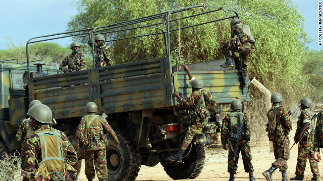 Kenyan soldiers climb into a truck as they prepare to advance into Somalia on October 18.
