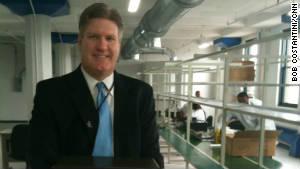 SavWatt CEO Michael Haug at his small company\'s assembly line. \