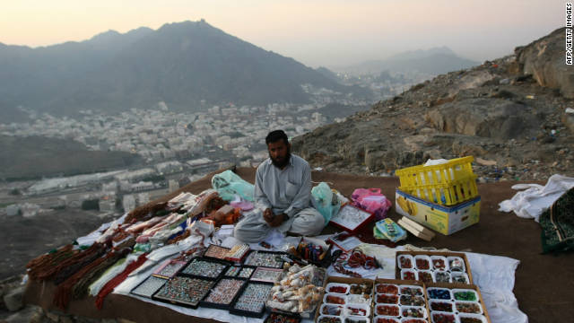 A man sells gifts to Muslim pilgrims on their way up Noor Mountain, Mecca, during the Hajj 2009. The Green Pilgrimage Network, says pilgrim cities need to address the culture of consumerism to become more sustainable. 