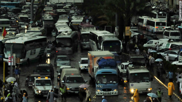 Traffic sit bumper-to-bumper in the flooded streets of Mecca during heavy rainfall in 2010. The newly-released &quot;Green Guide to the Hajj&quot; hopes to encourage pilgrims to look after the environment.