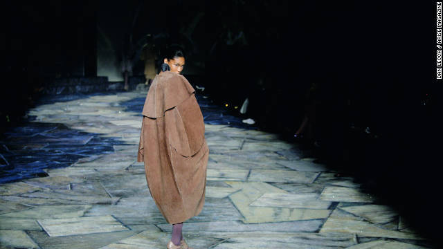 A model walks the catwalk wrapped in a coat from the Black Coffee fashion range.