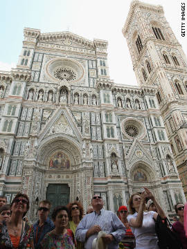 The Duomo is situated in the Piazza del Duomo. The facade of the Duomo is covered in pieces of pink, white and green marble. To the right of the picture is Giotto's Campanile, or belltower, a fine example of Renaissance design, which houses seven bells.