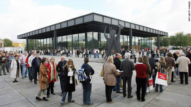 Visitors queue outside the Neue Nationalgalerie in Berlin, Germany. Adjaye cites the structure as a &quot;masterpiece&quot; and &quot;a temple of modernity.&quot;