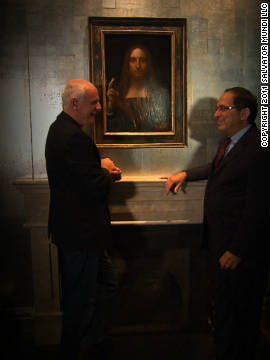 CNN presenter Nick Glass with Robert Simon, the scholar and dealer who was asked to study the painting in 2005 and eventually discovered its true identity, in front of &quot;Salvator Mundi.&quot;