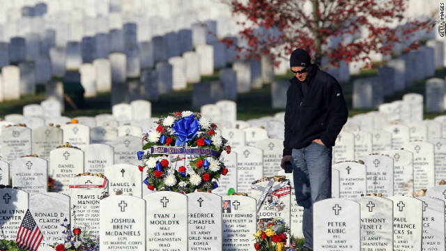 A man visits Arlington National Cemetery's Section 60, which is for those who died in the Iraq and Afghanistan wars.