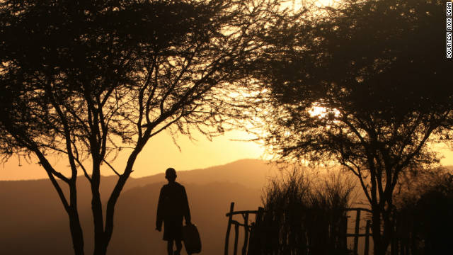A boy walks to the Omo River at sunrise to gather water in the village of Korcho. The river is crucial to the survival of the tribes that live along it.
