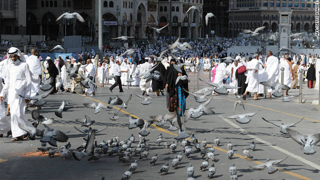 Pigeons fly over pilgrims near the Grand Mosque in the Saudi holy city of Mecca on Thursday. The event draws roughly 2.5 million pilgrims each year.