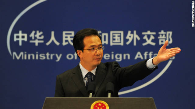 China's Ministry of Foreign Affairs spokesman Hong Lei gestures at a press briefing in Beijing on November 30, 2010.