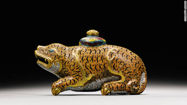 A gilt-bronze cloisonne enamel tiger waterpot and cover from the Qianlong period, on sale at Sotheby's London on 9th of November 2011 and estimated to fetch between approximately $320,000 (£200,000) and $480,000 (£300,000).