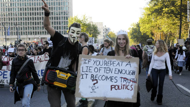 Another masked protester joins 6,000 people marching in Brussels, Belgium on October 15.