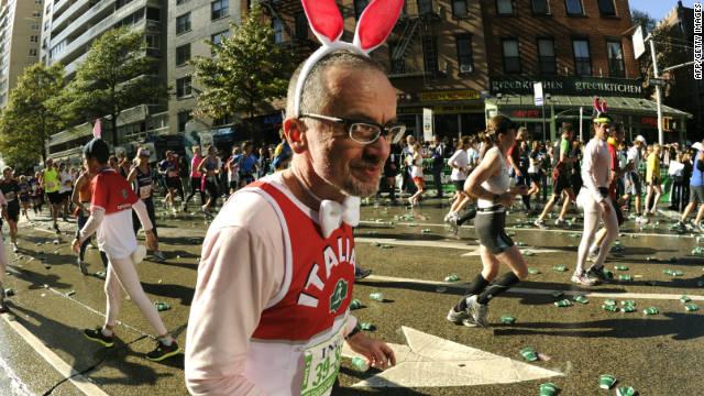 A runner wearing rabbit eats passes through Manhattan.