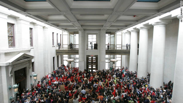 Opponents of Senate Bill 5 rally inside the Ohio statehouse February 22. Voters will decide Tuesday whether to repeal the law.