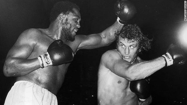Frazier and Joe Bugner compete during a world title eliminator fight at Earl's Court, London, in 1973. Frazier emerged the winner after a very hard-fought match.