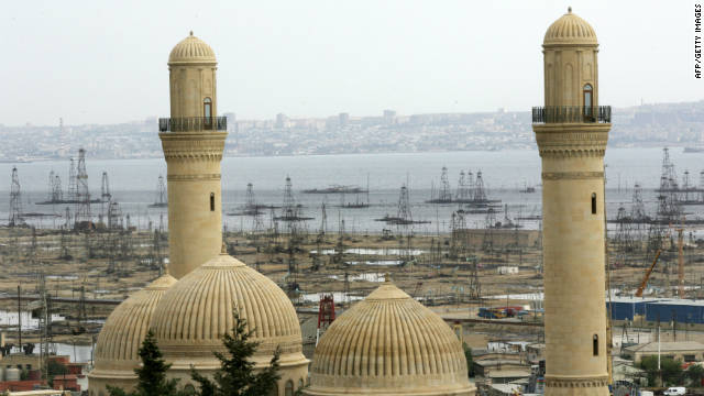 Oil derricks are glimpsed through the minarets of a mosque in Baku. Azerbaijan has vast oil reserves and at one point in the early 20th century was producing half of the world's oil output. 
