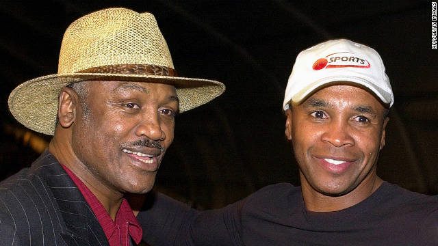 Frazier and Sugar Ray Leonard meet before Frazier's daughter Jacqui Frazier-Lyde fought Laila Ali during the women's super middleweight fight in 2001 in New York.<!-- --> </br>