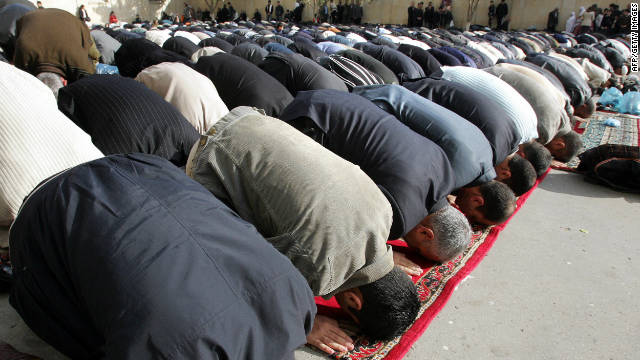 Muslim men bow to pray in a mosque in Baku. 93% of Azerbaijan's population is muslim according to the country's government.