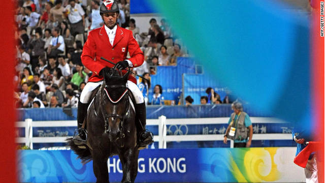 File photo of Eric Lamaze of Canada riding 'Hickstead' in the equestrian individual show jumping final of the 2008 Beijing Olympic Games on August 21, 2008 in Hong Kong.