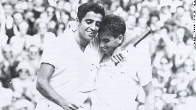 Rafael Osuna congratulates 1966 Wimbledon winner Manuel Santana of Spain after losing to him at the All England Club.
