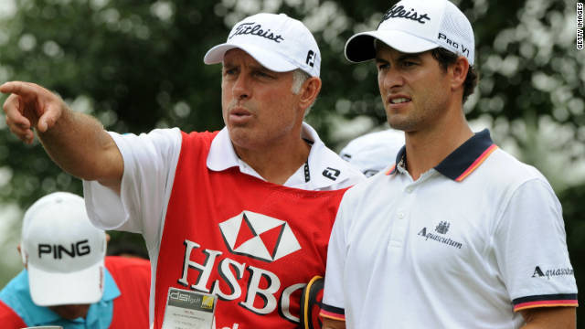 Steve Williams (left) started caddying for Australian golfer Adam Scott in July.