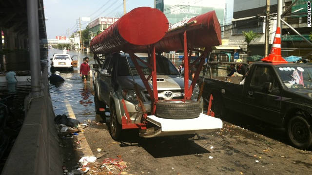 The truck effortlessly moved out of the water and onto the road by raising the customized floats.