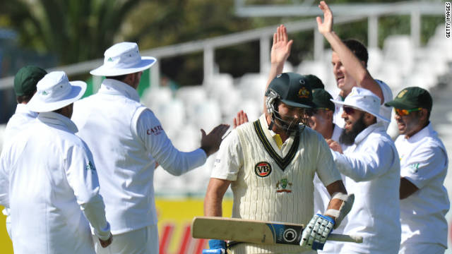 Australian batsman Shaun Marsh (C) trudges off after being dismissed by Morne Morkel in Cape Town.