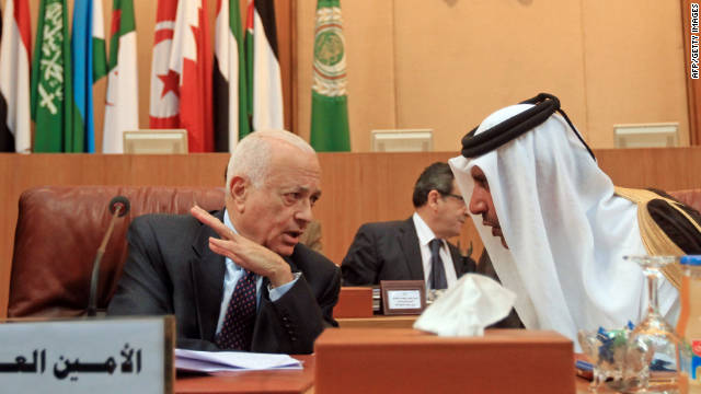 Qatari Premier and Foreign Minister Sheikh Hamad bin Jassem bin Jabr al-Thani, right, speaks to Arab League Secretary General Nabil al-Arabi during an emergency ministerial meeting of the Arab League on November 12.