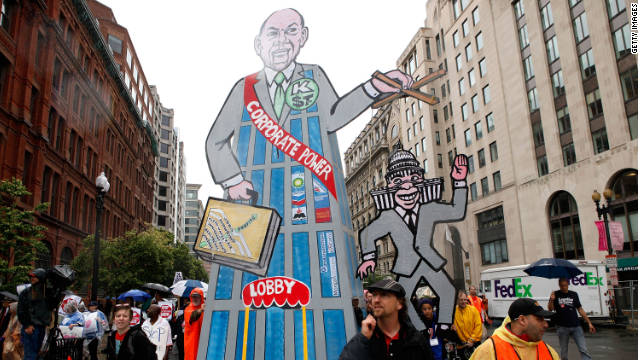 Activists carry a placard depicting Congress as a puppet of corporate lobbyists in a May, 2010 event in Washington.