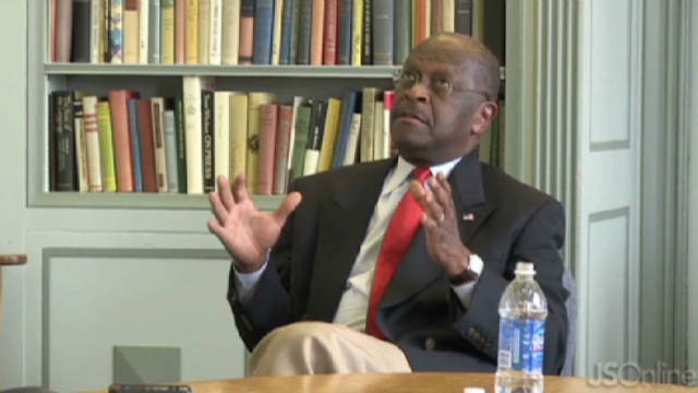 Herman Cain appeared to have difficulty responding to a question at a Milwaukee newspaper about U.S. policy on Libya.