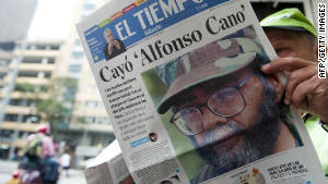 A man in Medellin reads about the killing of Alfonso Cano earlier this month.