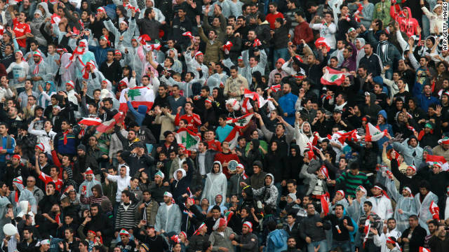 Lebanese fans celebrate their stunning 2-1 victory over South Korea in Beirut