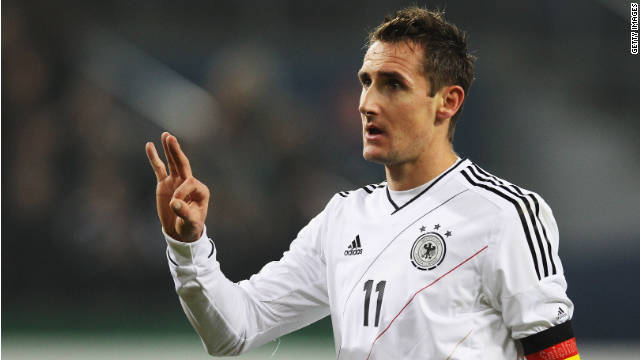 Miroslav Klose celebrates his goal in the 3-0 rout of the Netherlands in Hamburg